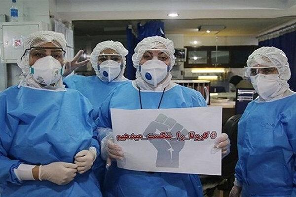 عکس ، کادر درمان با لباس های محافظتی در بازار علوی اهواز